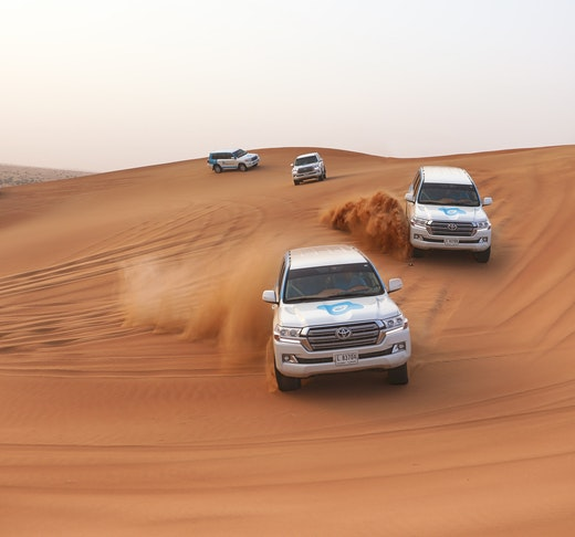 Premium Red Dunes by Quad Bike, Camel Ride, Sandboarding and BBQ Location