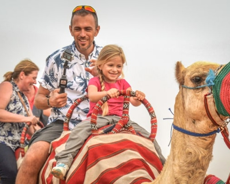 Premium Morning Quad Bike Sandboarding and Camel Ride Ticket