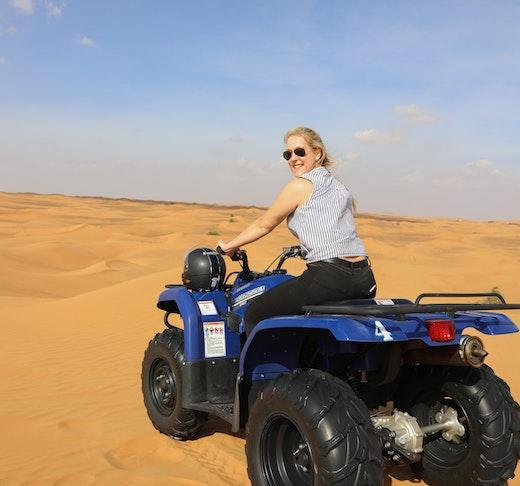 Premium Morning Quad Bike Sandboarding and Camel Ride