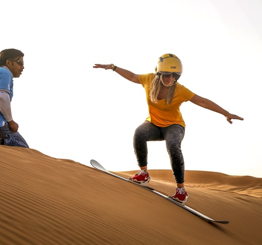 Premium Morning Quad Bike Sandboarding and Camel Ride Location